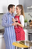 Young Fresh Married Couple In The Kitchen Cooking Together Pasta.