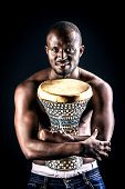 African american man posing with his drum. Over black background.