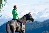 foto of horse-riders  - Woman riding horse - JPG