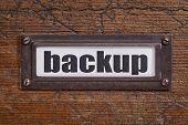 backup - file cabinet label, bronze holder against grunge and scratched wood