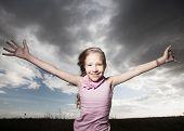 Happy smiling child at summer. Hurricane
