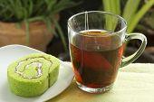 Roll Pandan Cake And Hot Tea