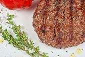 grilled beef steak with herbs and pepper