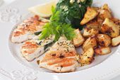 Grilled chicken breast stuffed with spinach, served with roasted potato