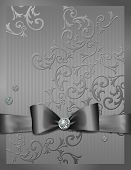 Silver embossed paper with bow and diamond