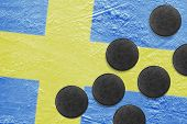 The Swedish Flag And Washers On The Ice