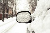 Car Mirror Covered Of Snow. Outside