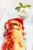 Cheese pancakes with cherry sauce