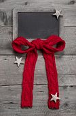 Menu Board For Christmas With Red Ribbon And Stars On Grey Wooden Background