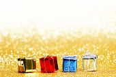 Colorful gift boxes on glitter golden background