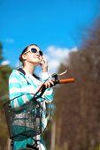 Teenage Girl On Bicycle Enjoying The Spring Sun. Outdoors Portrait.