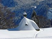 Snowbound Chapel In The Austrian Alps