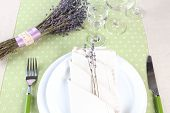 Dining table setting with lavender flowers on table background