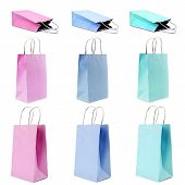 foto of reusable paper shopping bag  - nine empty shopping paper bags in pastel colors - JPG