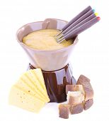 Fondue, rusk and slices of cheese isolated on white