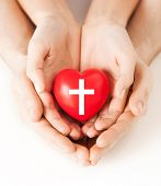 Постер, плакат: religion christianity and charity concept family couple hands holding red heart with christian cr