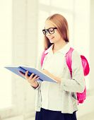 education and school concept - little student girl reading book at school