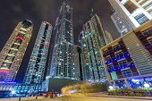 DUBAI, UAE - 2 APRIL 2014: Skyscrapers of Dubai Marina at night, UAE. Dubai Marina is a district in