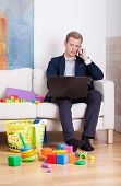 Businessman Trying To Work At Home