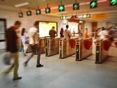 people on subway station blur motion