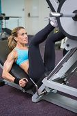 High angle view of a fit young woman doing leg presses in the gym