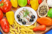 Anchovy fillets with olives and vegetables around