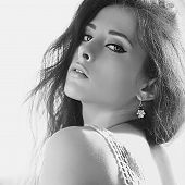 Seductive Flirting Woman With Beautiful Makeup. Black And White Portrait