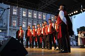ZAGREB, CROATIA - JULY 19: Members of folk groups Sveta Kata from Zemunik, Croatia during the 48th International Folklore Festival in center of Zagreb, Croatia on July 19, 2014