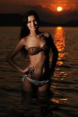 young beautiful woman in the sunset on the beach at lake Balaton