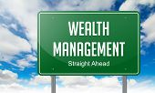 Wealth Management on Highway Signpost.