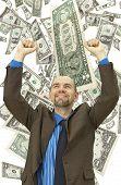 Happy businessman on the money background