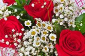 Red roses bouquet - beautiful floral background