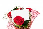 Roses bouquet and paper card isolated on white background