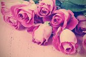 Happy Valentines Day Retro Vintage Style Pink Roses On Pink Wood Background.