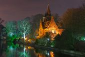 Fairytale night landscape at Lake Minnewater in Bruges, Belgium