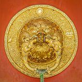 stock photo of karnataka  - Beauriful golden door handle at Namdroling Monastery  - JPG