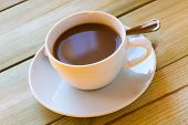 Milky Coffee Cup On Wooden Table