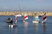 Sailing school participants ride sailboats in Herzliya Marina