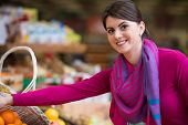 pic of department store  - Beautiful Young Woman Shopping For Fruits And Vegetables In Produce Department Of A Grocery Store  - JPG