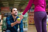 stock photo of department store  - Beautiful Young Couple Shopping For Fruits And Vegetables In Produce Department Of A Grocery Store  - JPG