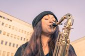 Beautiful Young Woman Playing Tenor Saxophone
