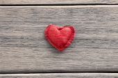 Red Valentine Heart Symbol On Wood Background