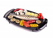 Grilled seabass on grill with vegetables.