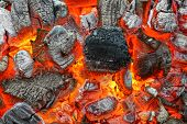 stock photo of charcoal  - Hot Charcoal with Bright Flames in BBQ Pit - JPG