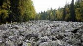 stock photo of ural mountains  - Stone river Qurum is a big boulder field one of the most amazing natural phenomena mountains of the Urals - JPG