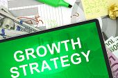 Tablet with words growth strategy