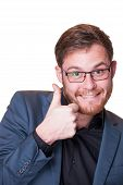 image of enthusiastic  - Enthusiastic bearded young man wearing glasses giving a thumbs up gesture of approval and success as he looks at the camera with a joyful smile isolated on white - JPG