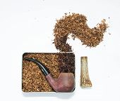 foto of tobacco-pipe  - Smoking pipe in a tin tobacco box - JPG