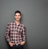 Charming Young Man In Checkered Shirt Smiling