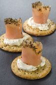 Salmon Rolls With Soft Cheese On Cracker
